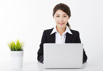 young businesswoman working with  laptop and green plant