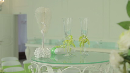 table with wedding accessories and two glasses