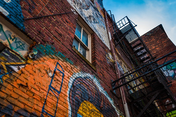 Looking up at graffiti and old staircases in Graffiti Alley, Bal