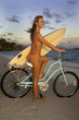 canvas print picture - girl with bike and surfboard