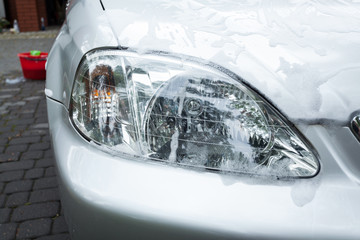 Soap suds on a headlight