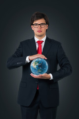 young businessman holding Earth