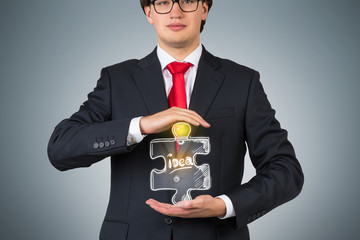 businessman holding puzzle