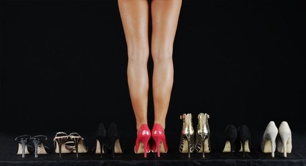 Young female body with collection of high heels shoes
