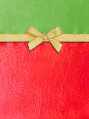 Gold ribbon on green and red  leather