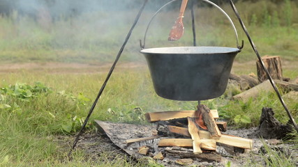Cooking stew at the camp