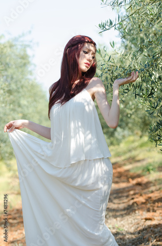 Tuinposter Olijfboom Portrait of a girl with white long dress in the olive grove