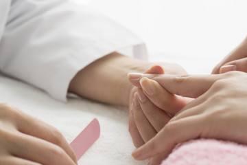 Women adjust the length and shape of the nail