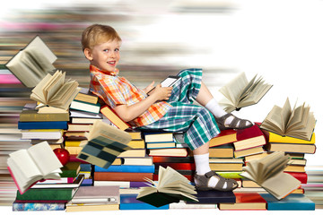 Little boy, rapid internet and a pile of books