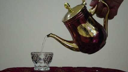 Pour hot water into a glass
