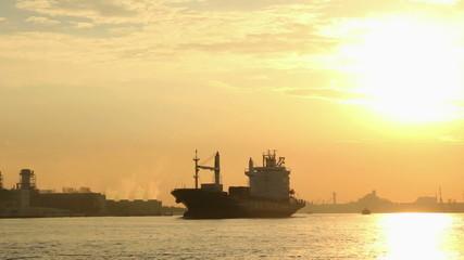 Cargo ship at sunrise, Bangkok thailand