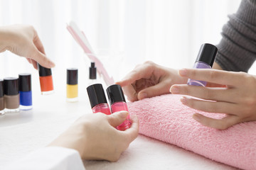 The woman who has decided the color of the nail polish