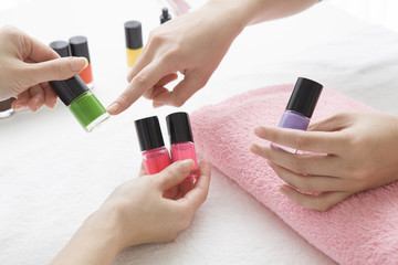 The lady who chooses the color of the nail