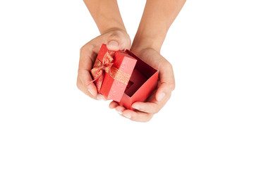 Man hands open lid of red gift box