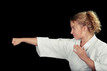 Young Karate Woman Wearing Kimono in Martial Art Pose