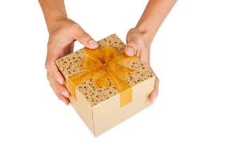 Man hands give golden gift box