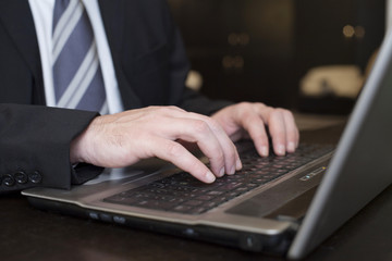 Business Man Typing On Laptop Computer Close up