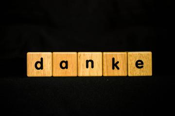 danke wood Cubic on black background