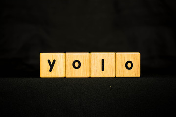 yolo wood Cubic on black background