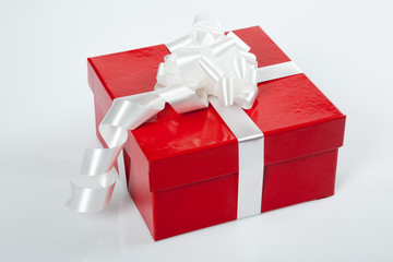 Red gift box with white bow for christmas