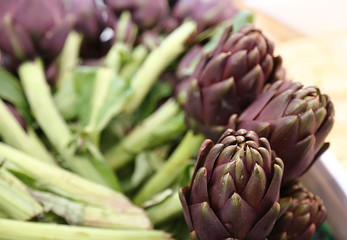 beautiful green artichokes for sale in stand of greengrocers