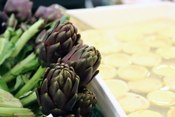 artichokes for sale in stand of greengrocers to local market