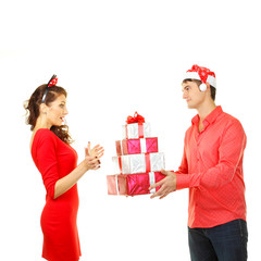 man in santa hat gives a lot of bright gifts for Santa girl
