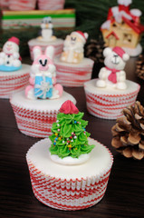 Sugar figurine Christmas tree on the muffin