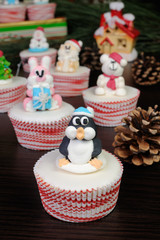 Sugar Christmas penguin figurine on a muffin