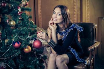 Beautiful  girl  near the Christmas tree.