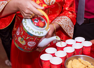 the bride serving the tea for the elders