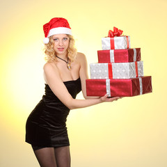 Christmas woman holding gifts.