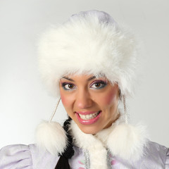Emotional and cheerful Santa Girl in white and blue outfit.