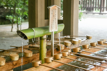 wash site in front of the entrance of japanese temple for people