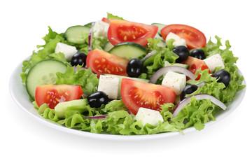 Griechischer Salat mit Tomaten, Feta Käse und Oliven in Schüss