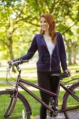 Pretty redhead with her bike