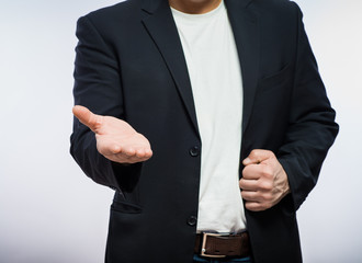Businessman offering for handshake over white background