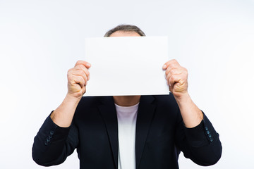 Businessman showing the big blank card in hand