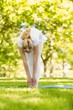 Peaceful blonde doing yoga in the park - 74822063