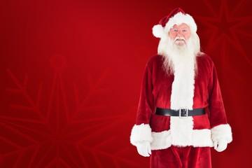 Composite image of jolly santa smiling at camera