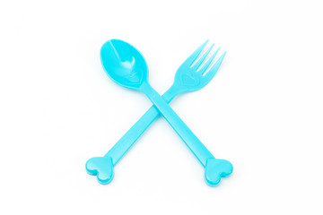 Colorful spoon and fork on white background