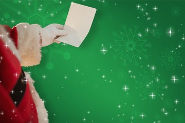 Composite image of father christmas holding a paper