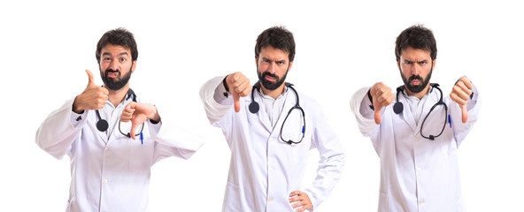 Doctor doing a bad signal over white background