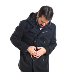 Man with stomachache over white background
