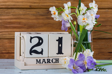 First day of spring vintage callendar and fresh flowers