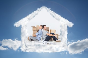 Composite image of couple sitting back-to-back