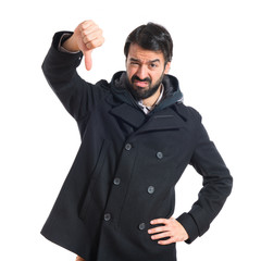 Man doing a bad signal