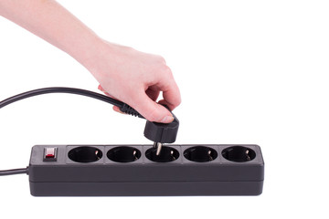 Hand puts the plug