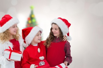 Composite image of cute children with gifts