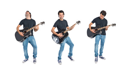 Handsome man with guitar over white background